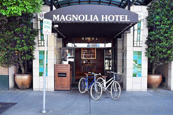 Bikes outside street level entrance of Magnolia Hotel