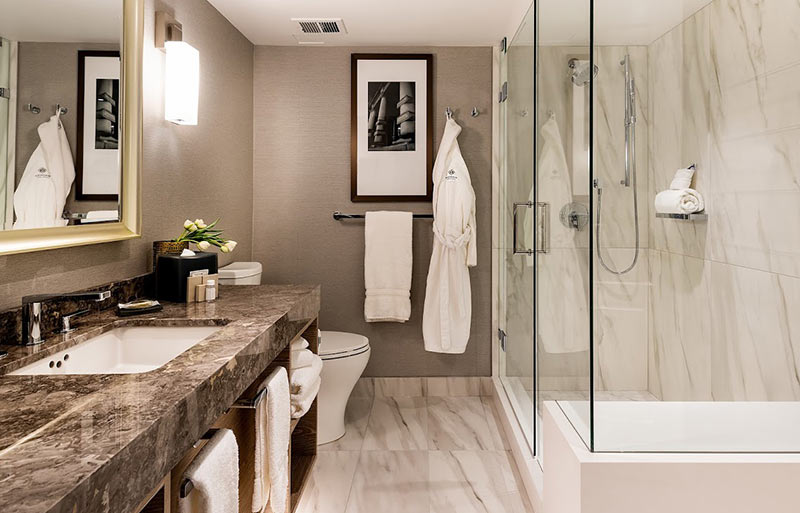 The new bathrooms in the Magnolia Hotel in Victoria, BC feature deep soaking tubs and oversize showers.
